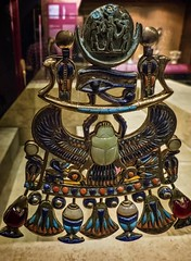 A moon pectoral from the tomb of King Tutankhamun New Kingdom 18th Dynasty 1332-1323 BCE (mharrsch) Tags: pectoral gold kingtutankhamun tomb burial funerary newkingdom 18thdynasty 14thcenturybce egypt ancient pharaoh ruler monarch king discoveryofkingtut exhibit newyork mharrsch premierexhibits