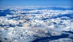 Aeroflot B777-300ER cruising above the Sayan Mountains, Russia (Jaws300) Tags: snowy sayan mountain range 2000m 2700m high mongolia aeroflot b777300er above afl su b777300 b777 b773 boeing flying scenery cruising cruise flight inflight outthewindow pax from wing blue sky skies blueskies sayanmountains mountainrange russia siberia