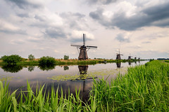 Classic Dutch Landscapes #4 (SkyBlue Photography Pro) Tags: country path landscape windmills mills kinderdijk holland south zuid nederland netherlands cloudscape landschap pretty river light green painting blue flowers nature water sky bright master unesco windmolens polarization bw