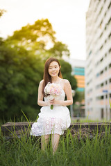 Little Miss Sunshine (Tobey86) Tags: nikon 85mm afs f18g photography girl grass flare sun sunset evening d810 singapore bukit panjang