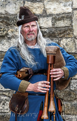 A medieval musician outside Lincoln castle (Ian Lewry Photographer) Tags: musician medieval lincoln instrument bagpipe ianlewry britain england
