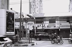 With Nature (35mm) (jcbkk1956) Tags: bangkok thailand sukhumvitroad thonglo traffic street streetfurniture signs film 35mm analog manualfocus ilford pan100 contax 167mt carlzeiss 45mmf28 worldtrekker