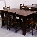 Large dark wood dining table E116 chairs E35 each