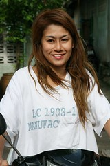 pretty woman on a motorcycle (the foreign photographer - ฝรั่งถ่) Tags: pretty long haired woman brown hair khlong thanon portraits bangkhen bangkok thailand canon kiss