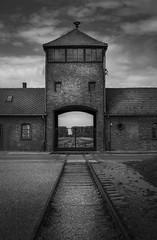 The gatehouse at Birkenau (Brad@Shaw) Tags: auschwitz birkenau concentrationcamp architecture blackwhite blackandwhite bw dark moody clouds railway europe eu transport train canonef1635mmf4lisusm canon worldwarii bricks poland polska