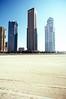 Towers across the sand, JLT Dubai (elkarrde) Tags: c41 colornegativefilm filmisnotdead filmisalive scanner:brand=plustek scanner:model=opticfilm8100 analoguephotography analogphotography filmphotography analogue film plustek opticfilm8100 plustekopticfilm8100 vuescanx6492 city skyline mydubai dubai cityscape cityline middleeast jlt jumeirahlakestowers architecture towers highrise desert uae دبي jumeirahlaketowers almas أبراجبحيراتالجميرا dubayy unitedarabemirates دولةالإماراتالعربيةالمتحدة morning shadow sun sky earlymorning november autumn 2013 november2013 autumn2013 twop pentaxart justpentax pentax mzs pentaxmzs filmcamera camera:brand=pentax camera:model=mzs camera:mount=k camera:mount=kaf2 camera:format=135 camera:type=slr