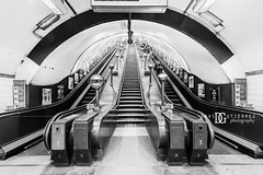 """Art Deco II"" Swiss Cottage London Underground Tube Station, London, UK (davidgutierrez.co.uk) Tags: london architecture art city photography interior davidgutierrezphotography nikond810 nikon urban travel color londonphotographer photographer uk people blackandwhite londonunderground blackwhite monochrome stairs bw black white blackandwhitephotography arts artdeco abstract tube unitedkingdom afsnikkor1424mmf28ged 1424mm 伦敦 londyn ロンドン 런던 лондон londres londra england europe beautiful cityscape davidgutierrez capital structure britain greatbritain centrallondon ultrawideangle d810 escalator buildings lights transport light design tubestation symmetry building station londonboroughofcamden swisscottage swisscottagetubestation lamp indoor interiors"