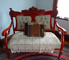 Chair with concertina in the Immigrant House, Czech & Slovak Museum (ali eminov) Tags: cedarrapids iowa museums nationalczechslovakmuseum chairs embroidery musicalinstruments concertina