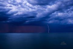 May 30: Touchdown (_Matt_T_) Tags: grimsby smcpfa35mmf20al nd8 storm simay2017 bewareyourtinfoilhats lightning singlechallenge weather lakeontario dusk crop