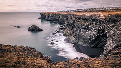 Hellnar - Iceland - Seascape photography (Giuseppe Milo (www.pixael.com)) Tags: view water hills hill sea iceland west cave travel clouds longexposure sky seascape geotagged beautiful gatklettur rocks arnarstapi is onsale
