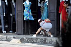 Gotcha! (Roving I) Tags: girls stripes backpacks dogs animals pets runaways shops stores clothing dresses suits tourism hoian vietnam grabbing