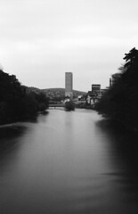 monolith (victoriousviktor) Tags: switzerland zurich architecture swiss mill river limmat reflection cloudy evening trees long exposure shadow nd400 canon a1 fd5014 film ilford delta100