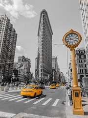Yellow taxis and Golden Clock at the Flatiron Building in New York (patuffel) Tags: yellow taxis flatiron building new york usa city clock fifth avenue golden skyscraper