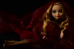 """...I´ll be Isolde or Marion for you..."" (jessandgrace) Tags: doll portrait colorimage colors darkbackground light shadow fabric legs red figure hands face eyes greeneyed hair braids bighair strawberryblonde blonde golden ashlynnella eah everafterhigh pretty beauty glamour cute indoor"