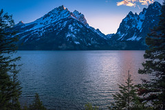 Jenny Lake (Cramer Imaging) Tags: photo photography nature outdoors outdoor natural landscape scenic scenery mountain mountains sky cloud clouds plant tree pine pinetree forest wyoming nationalpark national park lake water reflection grandtetonnationalpark tetons snow blue bluehour twilight