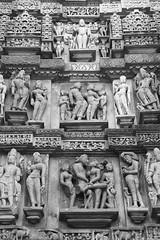 Khajuraho Carvings (peterkelly) Tags: bw digital india asia canon 6d khajuraho kamasutratemple carving carved stone temple statue sandstone decorative people man woman