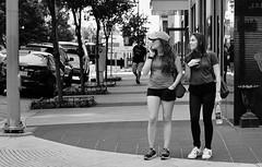 Playful (burnt dirt) Tags: houston texas downtown city town mainstreet street sidewalk corner crosswalk streetphotography fujifilm xt1 bw blackandwhite girl man woman people person couple pair group crowd walking talking standing looking boots heels stilettos sandals model photographer camera lens dress skirt shorts glasses sunglasses purse bag phone cellphone pose longhair shorthair ponytail kneehigh blonde brunette headphones cap hat asian friends bike bicycle prom lovers