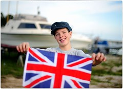 I'm Not English But Kiss Me Anyway (Steve Lundqvist) Tags: portrait kid kick kids boy england union jack english flag flags sea seaside ritratto british getty image images guy smile smiling hat newsboy news