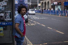 City Blues (Leanne Boulton) Tags: people portrait urban street candid portraiture streetphotography candidstreetphotography candidportrait streetportrait streetlife man male face facial expression eyes look emotion feeling blue blues road kiosk tone texture detail depthoffield bokeh naturallight outdoor light shade shadow city scene human life living humanity society culture denim canon canon5d 5dmarkiii 70mm character ef2470mmf28liiusm color colour glasgow scotland uk