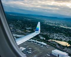 A Embraer ERJ-175LR Wing Over Sea-Tac International (AvgeekJoe) Tags: aerialphotograph d5300 dslr erj170200lr erj175 erj175lr embraer embraererj170200lr embraererj175 embraererj175lr internationalairport ksea n176sy nikon nikond5300 seatac seatacinternational seatacinternationalairport seattle seattletacomainternational seattletacomainternationalairport washington washingtonstate aerial aerialphoto aerialphotography aircraft airplane airport aviation jetliner plane winglet