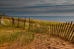 Lake Michigan sunset (wdterp) Tags: lakemichigan fence fencefriday hff sand beach dunes sunset goldenhour
