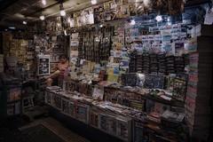 Time to read (karinavera) Tags: travel sonya7r2 magazines night kiosk urban street argentina buenosaires books people market cinematicphotography