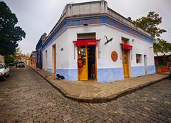 Corner in Colonia del Sacramento, Uruguay (` Toshio ') Tags: toshio colonia coloniadelsacramento uruguay shop history dog architecture building street corner sidewalk southamerica fujixe2 xe2