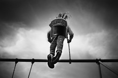 Swing (Kapuschinsky) Tags: blackandwhite bnw monochrome fineart fineartphotography sonyalpha sonya900 sonyphotographing 35mm emotive moody dramatic dramaticlight naturallight natruallight swing swingset playground outdoors outside girl candid lfestyle documentary centercomp minolta minolta35f2rs clouds sky childhood movement childhoodunplugged lookingup lowpov creativepov motion