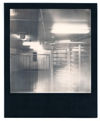 Impossible-103-BWSX70-ChicagoCTA (k.james) Tags: kenthenderson kjameshenderson impossible impossiblefilm instantfilm polaroid sx70 bw blackframe chicago subway turnstile chicagostop cta thel entry exit