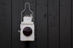 Buffer End Lamp - EXPLORED (paul indigo) Tags: paulindigo colour decor graphic horizontal lamp lantern light railway redlens streetphotography traincoach urbanexploration wood