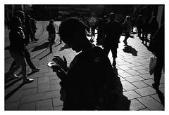 Street scenes (danieltim.net - HIATUS) Tags: urban filmphotography atmosphere mood personaldocumentary silouettes lighting light shadow obscure dark film impressionistic streetphotography europe people city summer helsinki finland figures