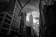 Empire State Building ([~Bryan~]) Tags: empirestatebuilding building cityscape city urbanlandscape trafficlight street newyorkcity nyc manhattan newyork urban blackandwhite monochrome bw usa ndfilter daytimelongexposure longexposure nd