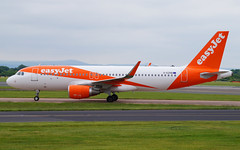 easyJet A320-214(WL) G-EZRB. 28/05/17. (Cameron Gaines) Tags: cn 7632 first flew hamburg finkenwerder daubt 27th march 2017 before being delivered easyjet gezrb 18th april flown luton same day current may a320214wl taxiing stand via bravo after arriving another short haul flight 280517 egcc man manchester greater england cheshire grass concrete taxiway runway arrival landing reverse thrust moving explore cloud formation