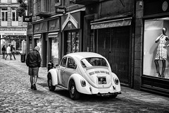 La jolie auto! (guillaumegesret) Tags: saintmalo black white moment street view candid car canon history story board brittany