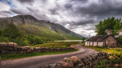Perfect place.... (Einir Wyn Leigh) Tags: scenery landscape solitude happy lake cottage scotland outside mountains cloudes storm rain love trees road track colour wet woods highlands june rugged light sky clouds