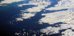 2017_05_09_muc-sfo_324 (dsearls) Tags: windowshot 20170509 flying aviation windowseat aerial white brown blue greenland vestgrønland ice glaciers rock bare desolate