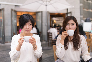 Young women drinking coffee after lunch
