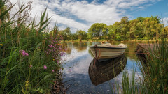 Summer cruise (Einir Wyn Leigh) Tags: landscape water boat summer colorful reflections foliage flowers lake river wales cymru natural nature clouds blue green outside