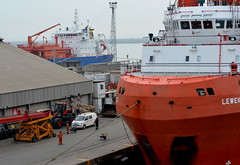 AFRICA:  BUSY WHARVES IN THE PORT OF LOME, TOGO,  (FREIGHTER CALLED LEWEK.) (vermillion$baby) Tags: africa boat color done flickr freighter green lome orange pier ship togo vessel wharf workboat ocean sea westafrica togosea port atlantic atlanticocean workboats bow water travel world international dock wharves boatstufff colora