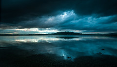 Nearly....But Not Quite   [Explored] (RonnieLMills) Tags: dark clouds natural vignette scrabo tower strangford lough reflections water ripples explore explored