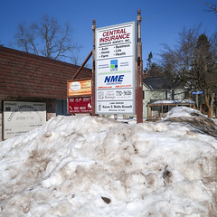 Seven businesses and all their small words words words. (Tim Kiser) Tags: 2017 20170218 centeravenue centerandmitchell centralinsuranceservicesagency centralinsuranceservicesagencyinc clipjoint february february2017 gaylord gaylordclinicalmassage gaylordmichigan highway27 img1110 ldcs michigan mitchellstreet nme nmeengineering northcenteravenue oldhighway27 oldus27 otsegocounty otsegocountymichigan route27 theclipjoint us27 ushighway27 usroute27 westmitchellstreet areacode989 beautyshop cloudlesssky dirtysnow dirtysnowpile downtown downtowngaylord insurance insuranceagency insuranceagencysign lawoffice lawofficesign multiplebusinesses northmichigan northernlowerpeninsula northernmichigan numerousbusinesses numeroussigns phonenumbers pile pileofsnow realestateoffice shingles signs smallwords snow snowpile sunny telephonenumbers toomanysigns toomanywords woodensignsupport