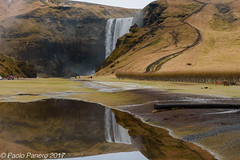 The Skogafoss Falls and their reflection in a puddle. ((Paolo P)) Tags: reflections mountains water landscape waterfall falls waterfalls iceland skogafossfalls sky frost puddle riflessi montagne acqua paesaggio cascate islanda cascatediskogafoss cielo brina pozzanghera