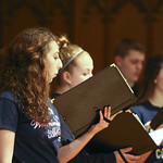Student singing in choir.