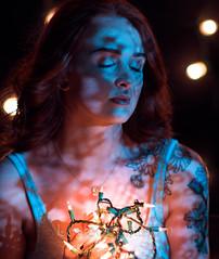 True love stories never have endings. (lawsonpix) Tags: select christmaslights portrait girl woman lowkey shadow experimental studio nikon 135f20 defocus d750 goodphoto bokeh