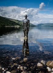 Mirror Man (daedmike) Tags: scotland lochearn mirrorman sculpture statue art reflections loch pebbles ripples shore