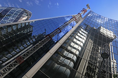London glass (matthewjoldfield) Tags: newlens lookingup reflection architecture cityoflondon lloydsoflondon gherkin crane building lamp blue stroll
