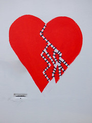 Trying to Mend a Broken Heart (Steve Taylor (Photography)) Tags: broken heart mend stiches staples lines letterbox art digital graffiti streetart black grey white red paint newzealand nz southisland canterbury christchurch tracks