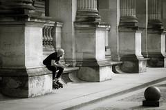 Carrousel du Louvre, Paris (2112) (cfalguiere) Tags: urban tuileries paris louvre datepub2017q206 candid rioller mans monochrome monochrom personne person columns bench homme carrousel sel20170625 techniques noiretblanc vanishingpoint persons sel20170709 sel20170722
