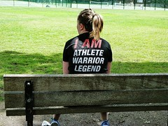 I am Athlete Warrior Legend (helenoftheways) Tags: girl tshirt bench park green grass candid peopletakenfrombehind london uk people sit sitting seated