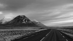 who does not adore a never ending road (lunaryuna) Tags: iceland northiceland landscape road ontheroad travel journey voyage roundtrip mountainrange blackwhite bw monochrome lunaryuna
